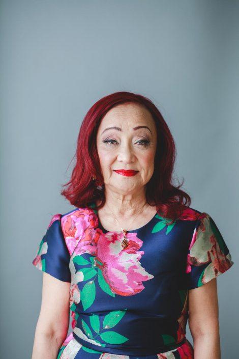 Creative portrait, senior, older woman, red hair, peony, clean, lauren dress