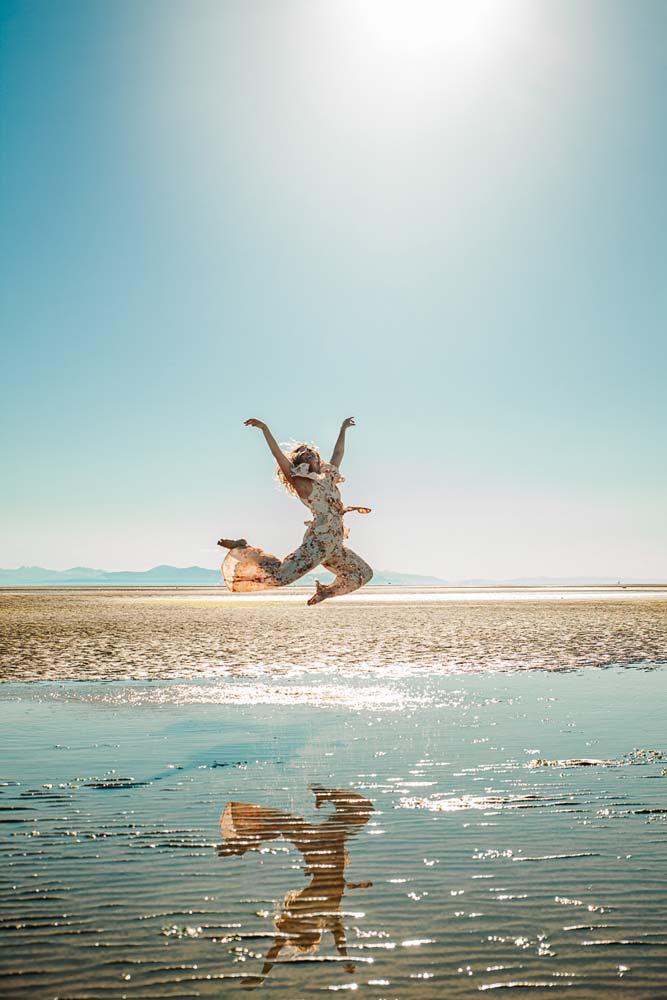 Vancouver Editorial Photographer, beautiful editorial photography, iona beach low tide woman leaps